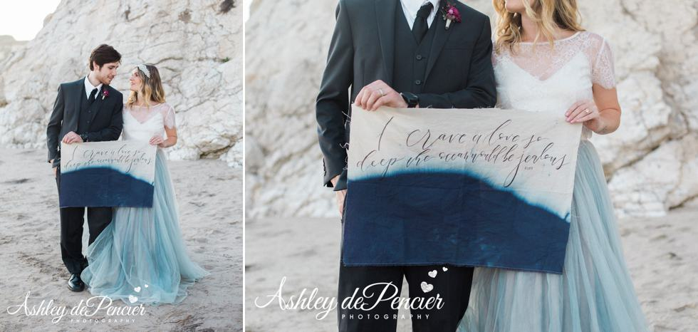 Handmade calligraphy sign being held by bride and groom