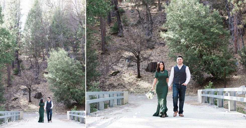 A couple strolling along a bridge