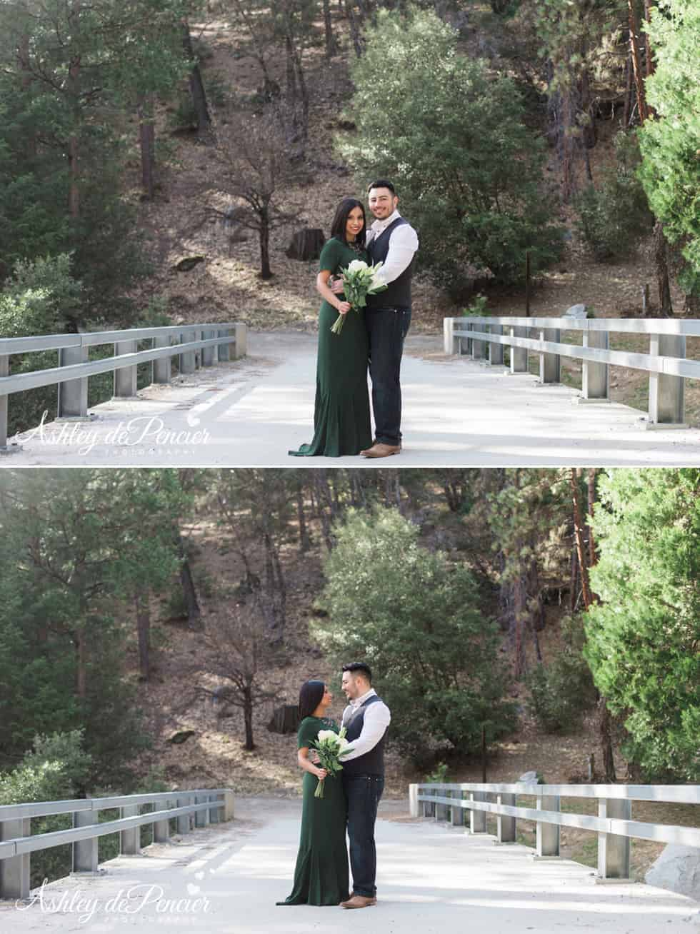 Engaged couple standing on a bridge