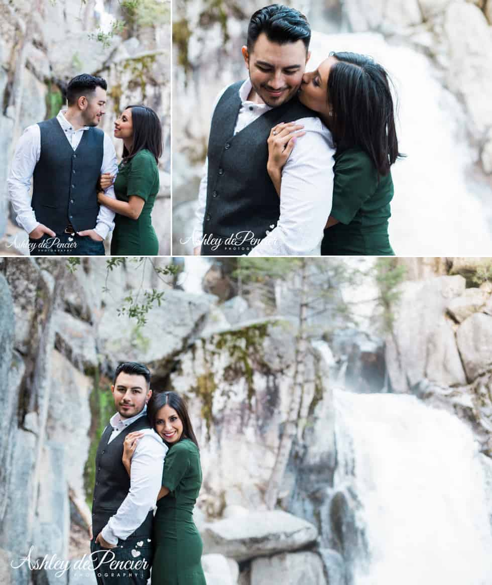 A couple standing by a waterfall
