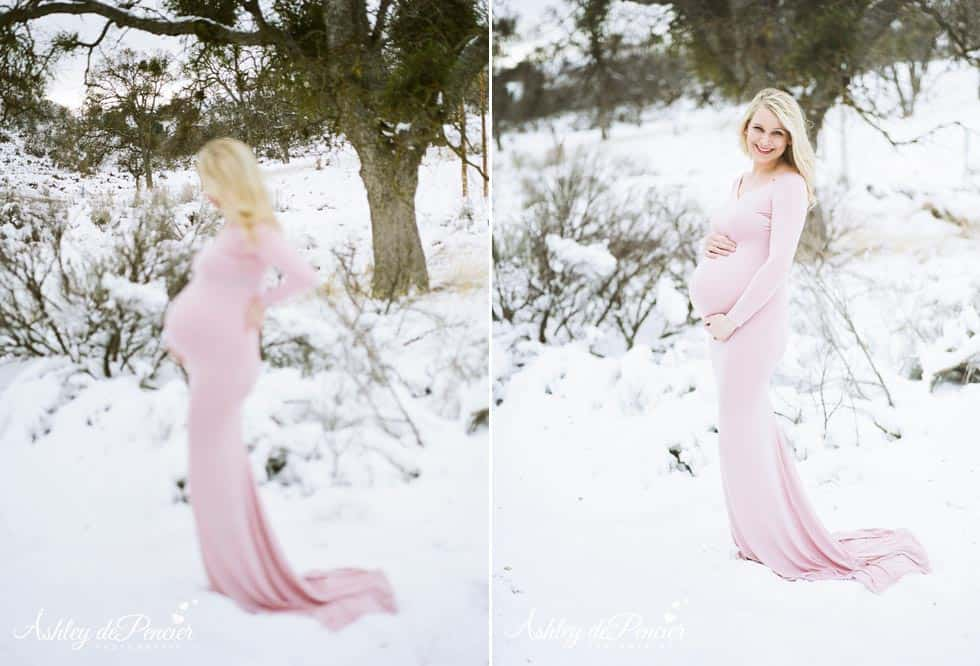 Beautiful blond pregnant woman standing in the snow