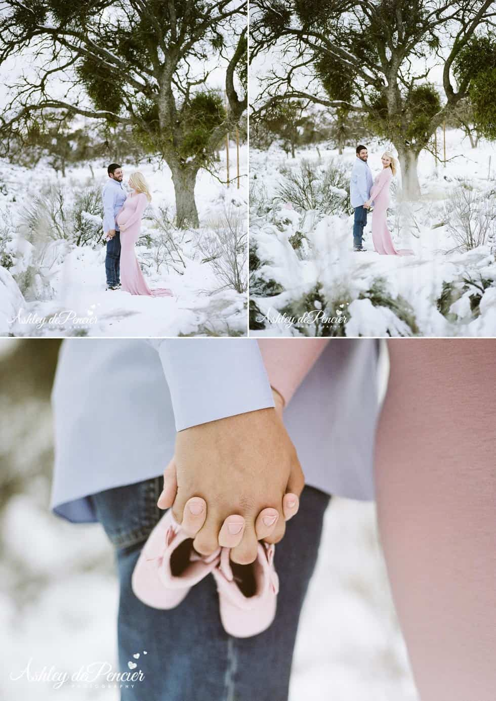 Man and woman standing in the snow holding hands