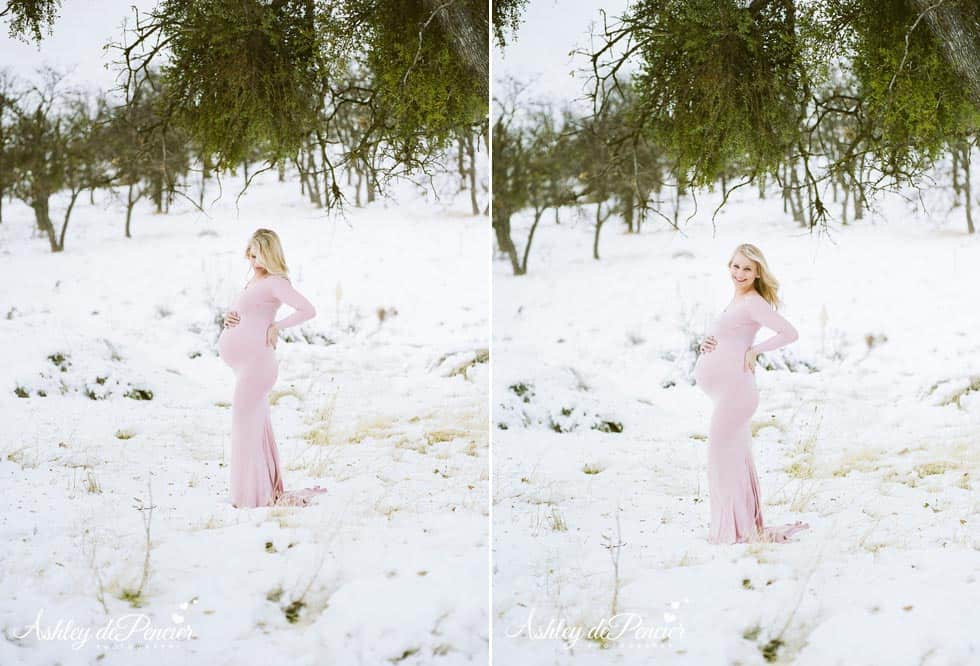 Pregnant lady standing in the snow in a pink dress