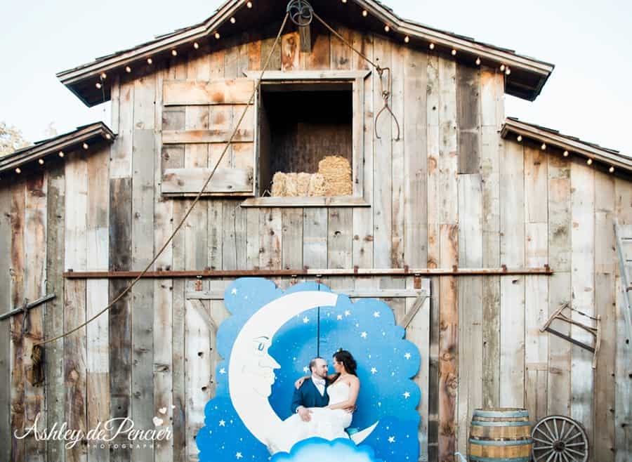 Couple sitting in front of a barn