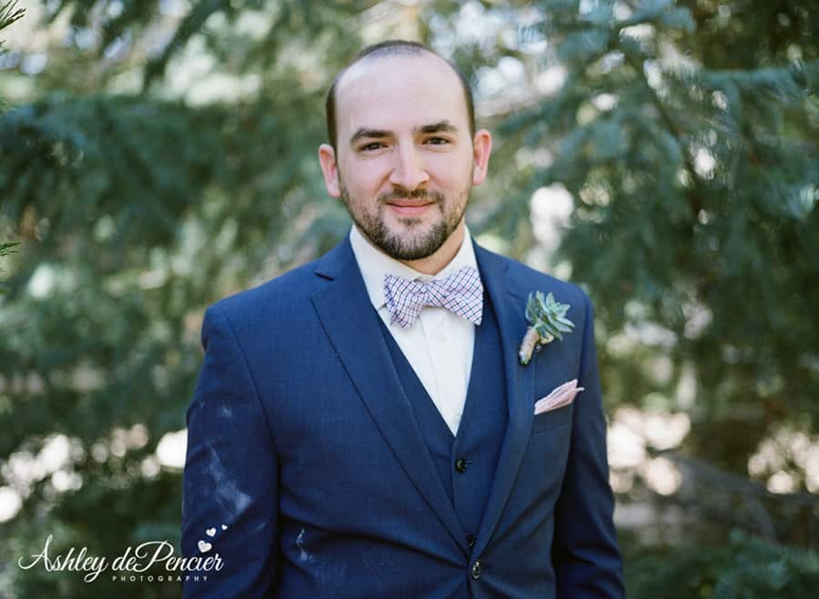 Portrait of a groom in a navy blue suit