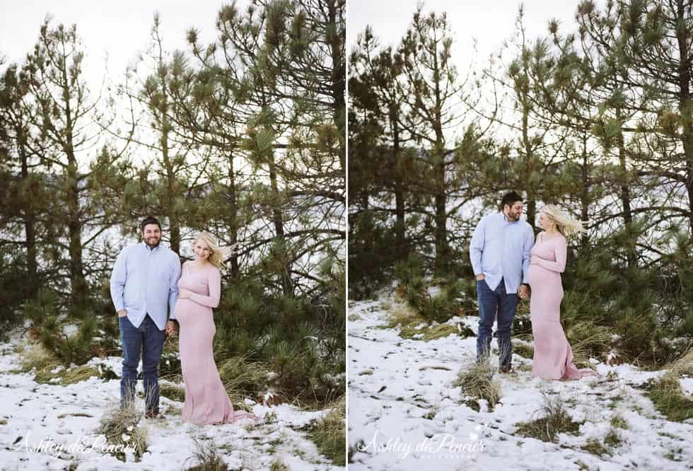Married couple taking portraits in the snow